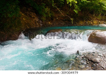 White water stream or rocky rapid river.  - stock photo