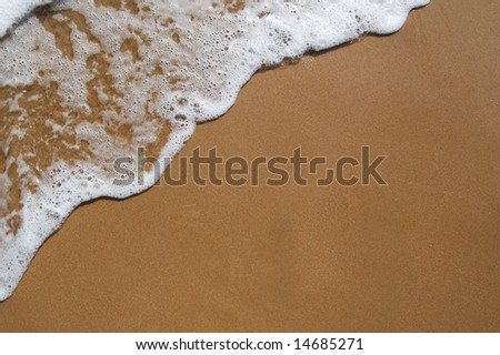White wave on perfect sand - stock photo