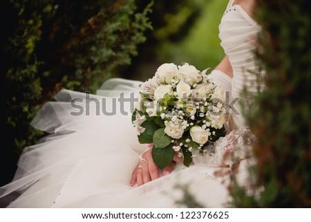 white wedding bouquet in park - stock photo