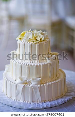 White Wedding cake at a wedding reception - stock photo