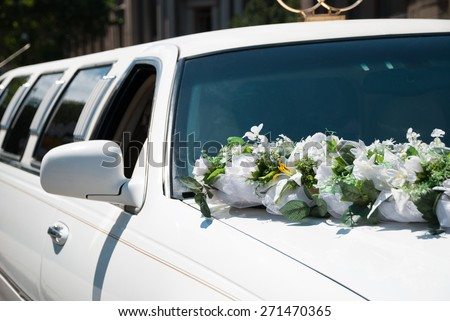 White wedding car with flowers - stock photo
