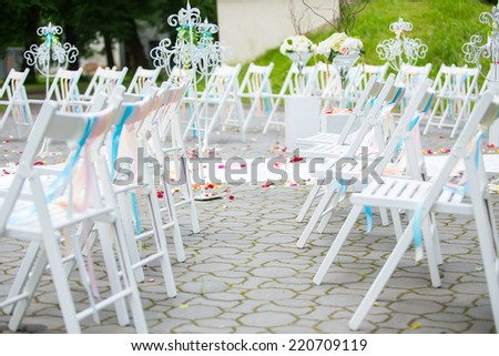 White wedding chairs decorated on ceremony - stock photo