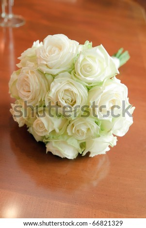 White wedding flowers on wooden table - stock photo