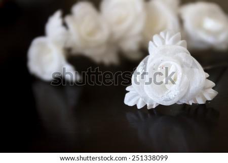 white wedding hair decoration isolated over black, horizontal orientation, nobody - stock photo