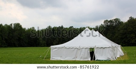 white wedding or events tent in the field - stock photo