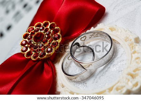 white wedding rings with engraving close up