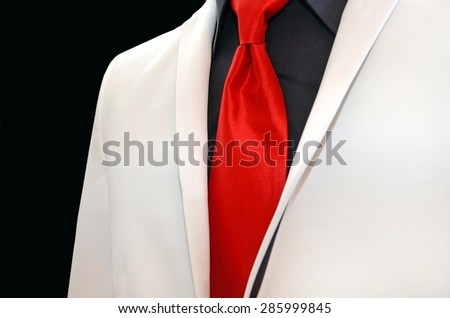 white wedding tuxedo with bold red tie and black shirt - stock photo