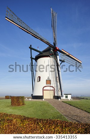 White windmill from the year 1740 in the village of Meeuwen (Aalburg) in the province of Noord-Brabant, the Netherlands - stock photo