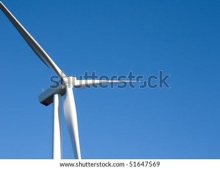 white windmill on blue sky