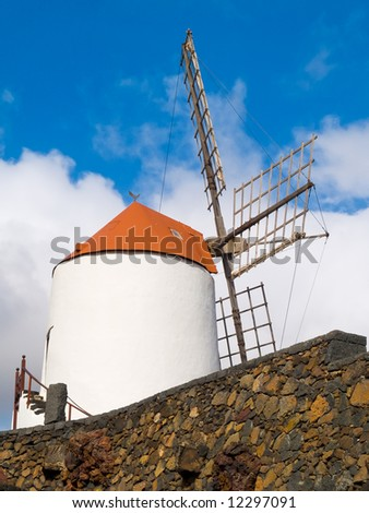 white windmill over cloud sky