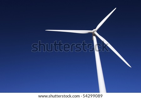 white windmill with blue and clear sky - stock photo