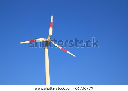 White windmill with red bar. - stock photo