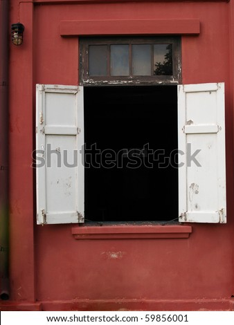 White window and red exposed concrete wall