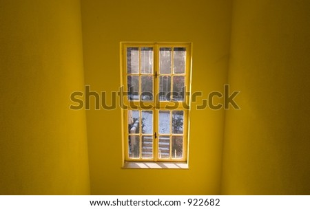 white window on a yellow wall