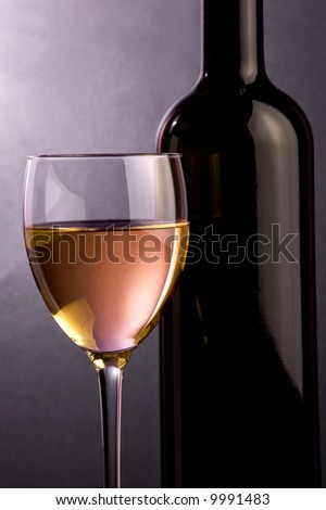 white wine a glass and a bottle