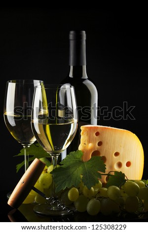 white wine and cheese on black - stock photo