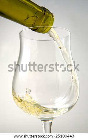 white wine and glass mouvement liquid on a white background - stock photo