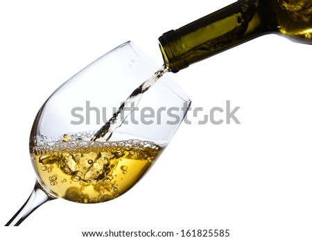 White wine being poured into a wineglass, isolated  on white ,saved clipping path - stock photo