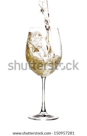 White wine being pourred into a glass
