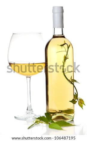 White wine bottle and glass. Isolated on white background - stock photo