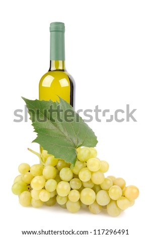White wine bottle and grapes isolated on white background