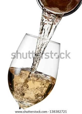 White wine flow in a glass from a jug