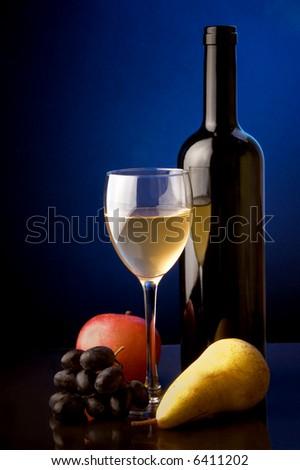 white wine glass bottle pear apple grape - stock photo