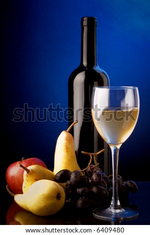 white wine glass bottle pears apples grapes - stock photo