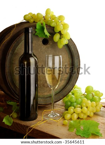 White wine, grapes and old barrel on white background - stock photo