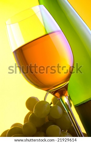 white wine green grape glass and a bottle
