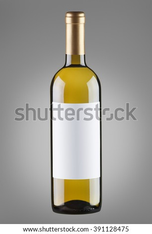 White wine in bottle with blank label. Isolated on gray background - stock photo