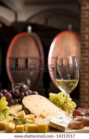 White wine in fine glass in front of an old blackboard - stock photo
