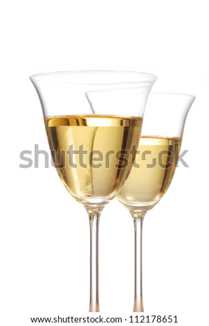 White wine in two crystal wine glasses - stock photo