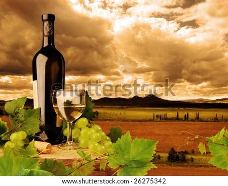 White wine on background of sunset landscape - stock photo