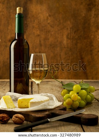 White wine on rustic background