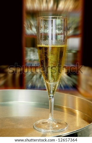 White wine on stainless steel plate.