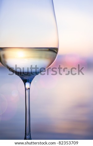 white wine on the sky background with clouds - stock photo