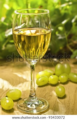 White wine on the wood surface, outdoor - stock photo