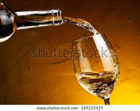 White wine pouring - stock photo