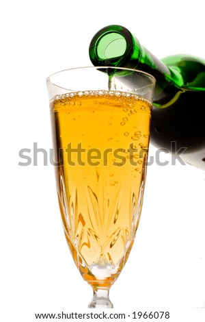 White wine pouring down from a wine bottle against white background - stock photo