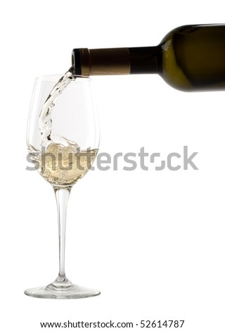 White wine pouring into glass. Isolated on white background - stock photo