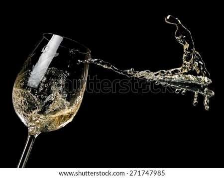 White wine splash on black background - stock photo