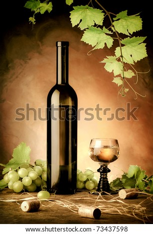 White wine still life in vintage style - stock photo