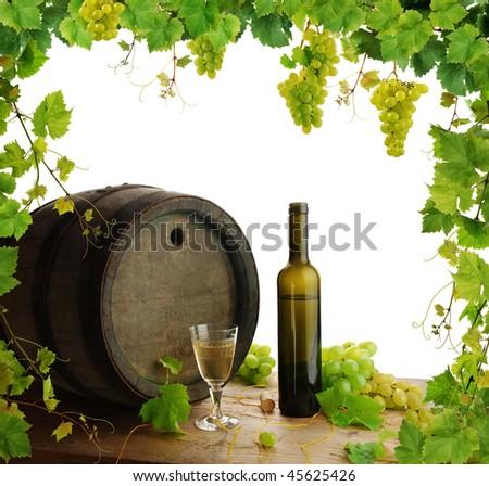 White wine still life with fresh grapevine border - stock photo