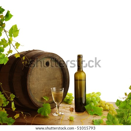 White wine still life with fresh grapevine on white background - stock photo