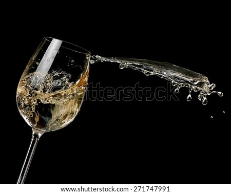 White wine up on black background - stock photo