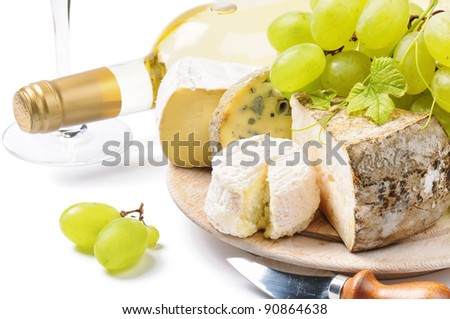 White wine with French cheese selection - stock photo