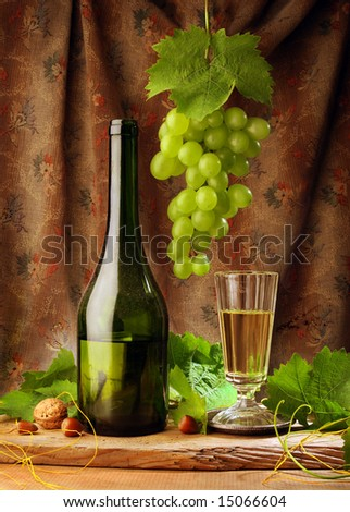 White wine with grape, leaves and nuts, retro style composition - stock photo