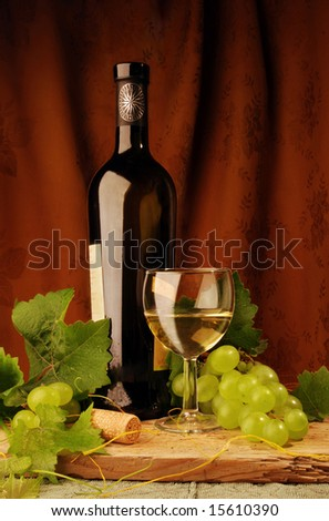 White wine with grapes - stock photo