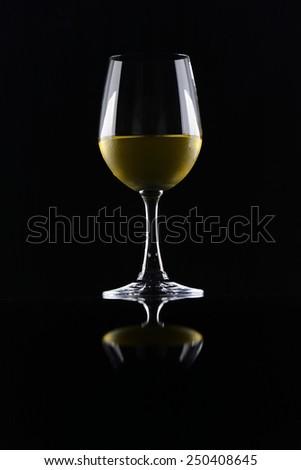 White wineglass isolated over black background - stock photo